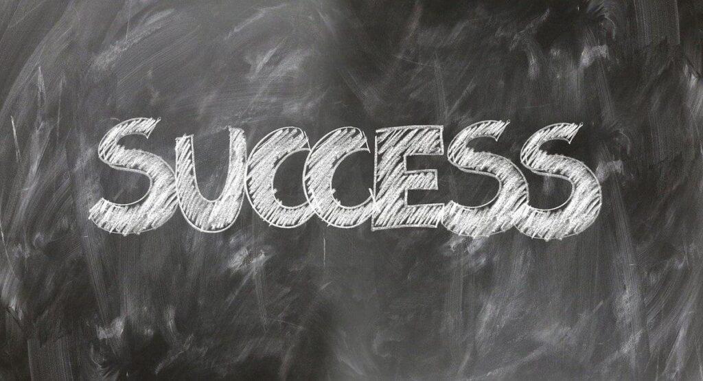 Success word written on board