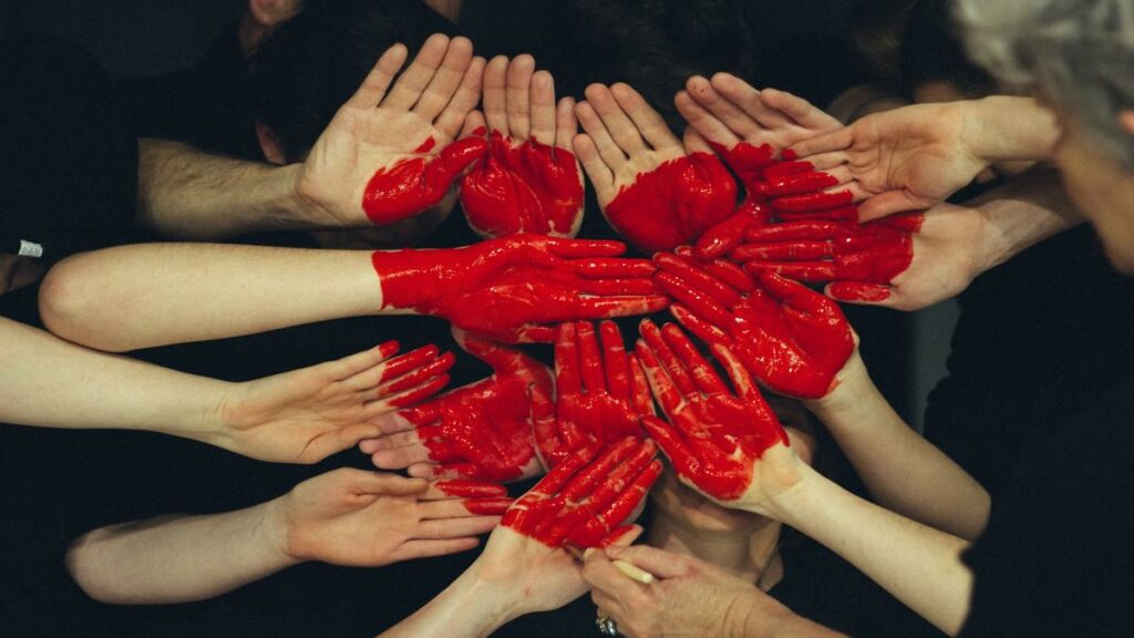 Many hands forming a heart sign