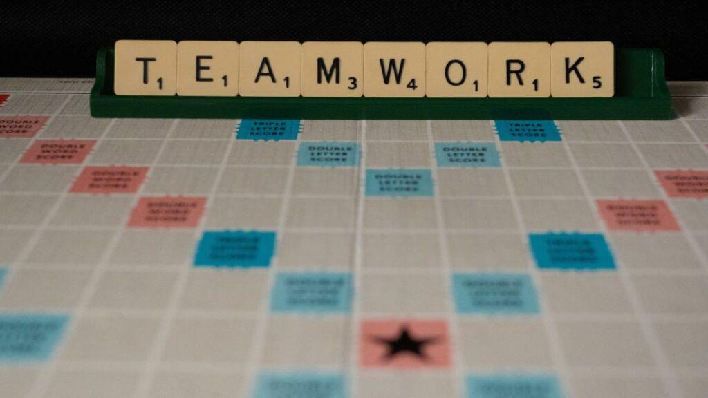 Scrabble game spells teamwork