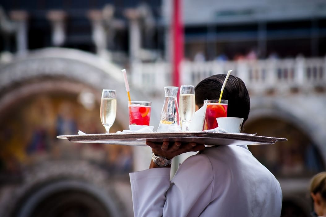 Event staffing - a waiter carrying a tray