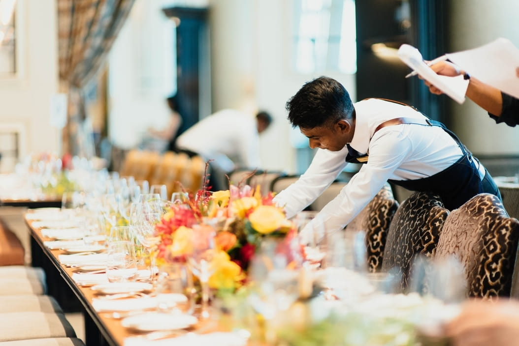 Wait staff setting up a banquet table