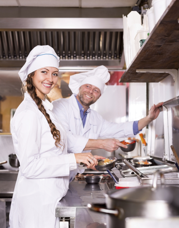 Chefs cooking at a professional kitchen