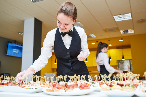 Wait staff preparing dishes for an event