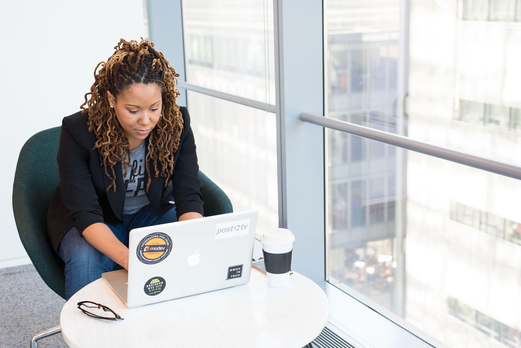 Woman in tech using laptop